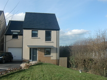 Spacious, modern four bedroomed detached house with a generous gardens