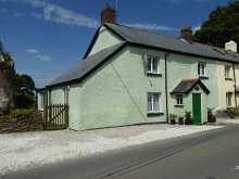 Delightful cottage with well maintained gardens to the rear and outstanding countryside views...